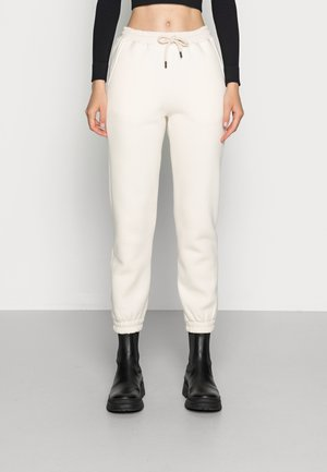 DULICE PANTS - Tracksuit bottoms - beige