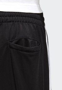 adidas Originals - FIREBIRD ADICOLOR TRACK PANTS - Tracksuit bottoms - black - 5