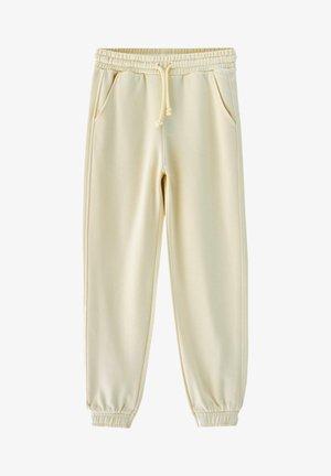 Teplákové kalhoty - mottled dark yellow