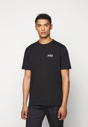 DONUMENT - Print T-shirt - black