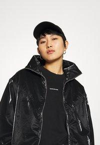 Calvin Klein Jeans - ZIP THROUGH - Windbreaker - black - 3