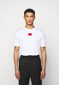 HUGO - DIRAGOLINO - Basic T-shirt - white - 0