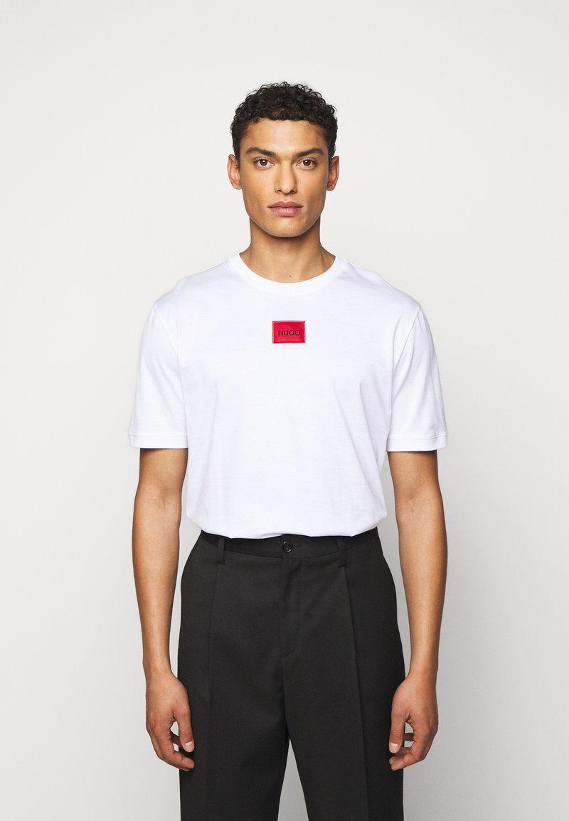 HUGO - DIRAGOLINO - Basic T-shirt - white