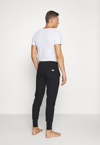 Diesel - UMLB-PETER TROUSERS - Pyjama bottoms - black - 2