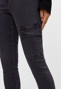 Bershka - Cargo trousers - black - 3