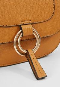 Dorothy Perkins - RING SADDLE - Across body bag - ochre - 6