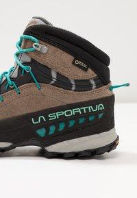 La Sportiva - TX4 MID WOMAN GTX - Hiking shoes - taupe/emerald - 5