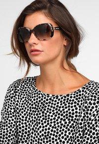 Prada - Sluneční brýle - spotted brown - 1
