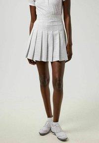 J.LINDEBERG - Sports skirt - micro chip croco - 0
