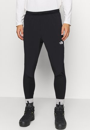 ACTIVE TRAIL HYBRID JOGGER - Tracksuit bottoms - black