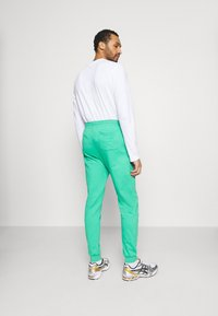 Urban Threads - COLOUR POP JOGGER UNISEX - Tracksuit bottoms - green - 2