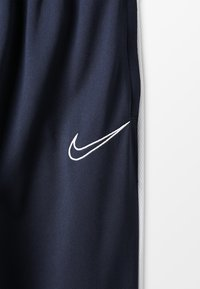 Nike Performance - DRY - Tracksuit bottoms - obsidian/white - 5