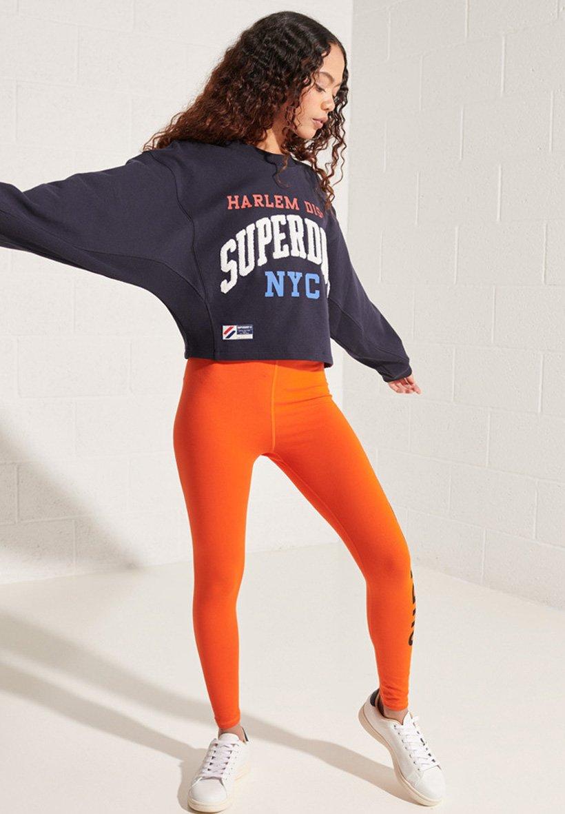 Women VARSITY ARCH BATWING - Sweatshirt