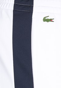 Lacoste Sport - TRACK PANT - Träningsbyxor - white/navy blue - 5