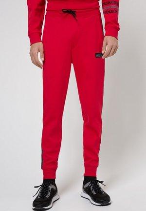 DONBURI - Tracksuit bottoms - red