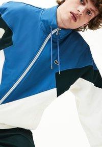Lacoste - veste en sweat zippée - white/green/blue - 3