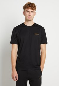 HUGO - DURNED ZA - T-shirt imprimé - black/gold - 0