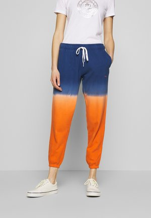 ANKLE PANT - Tracksuit bottoms - navy/orange ombre