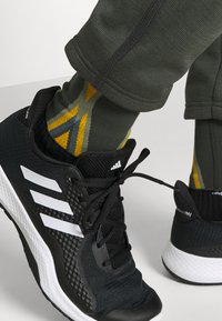 adidas Performance - ATHLETICS TECH COLD.RDY SPORTS PANTS - Pantalones deportivos - dark green - 3