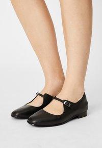Clarks - PURE FLAT - Ankle strap ballet pumps - black - 0