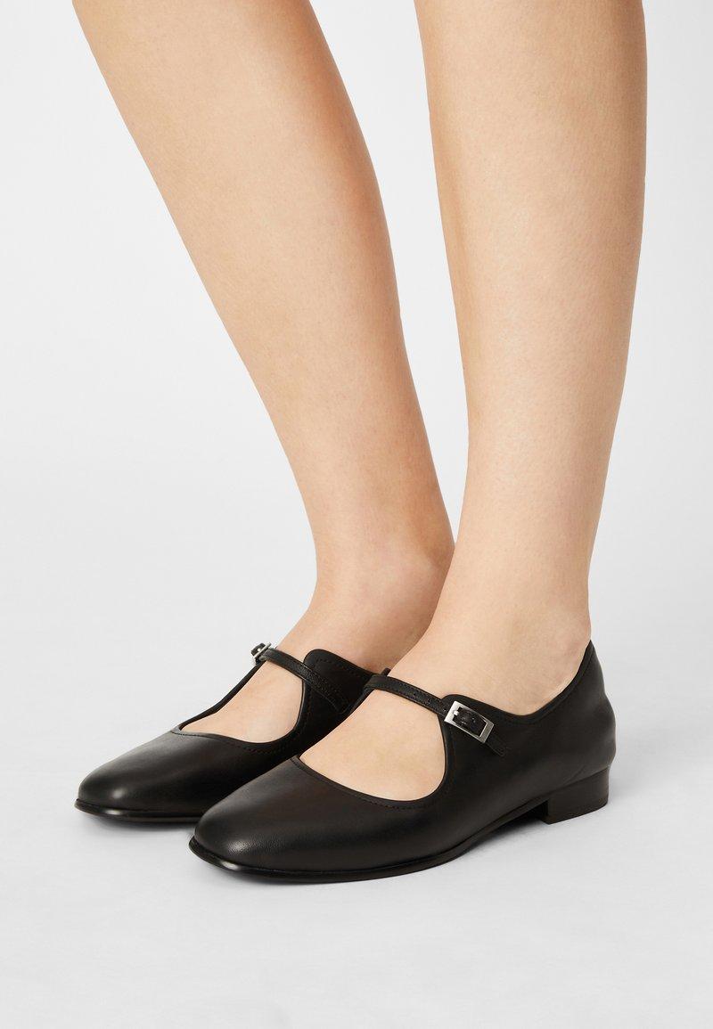 Clarks - PURE FLAT - Ankle strap ballet pumps - black