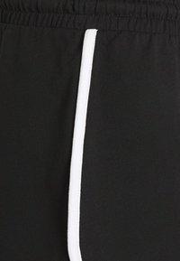Monki - Pantaloni sportivi - blue/black - 7