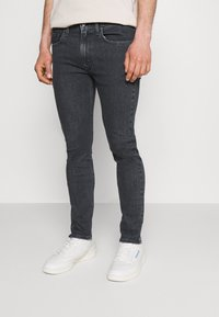 Levi's® - 519™ EXT SKINNY HI BALLB - Jeans Skinny Fit - monarda black - 0