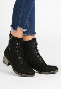 Rieker - Classic ankle boots - black - 0