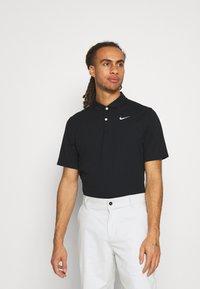 Nike Golf - DRY FIT ESSENTIAL SOLID - Koszulka sportowa - black - 0