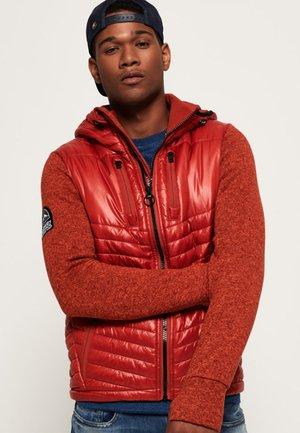 STORM HYBRID - Light jacket - orange