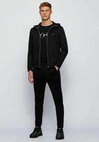 BOSS - TEE  - T-shirt imprimé - black - 1