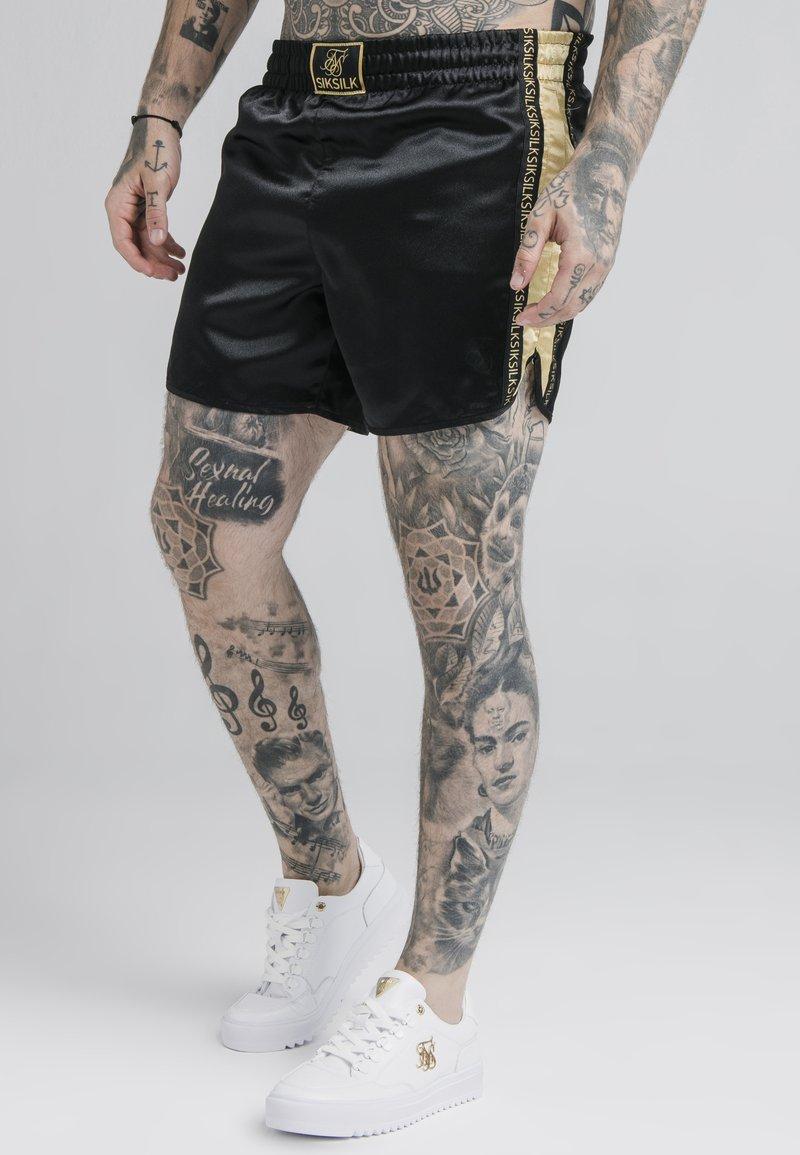 SIKSILK - MUAY TIE - Shorts - black/gold