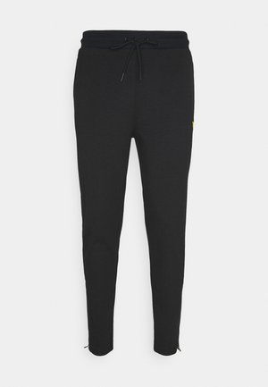TECH TRACKIES - Pantaloni sportivi - true black