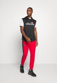 Ellesse - POTAT - Teplákové kalhoty - red - 1