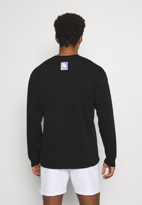 Nike Performance - TEE CHALLENGE - Long sleeved top - black - 2