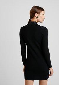 Calvin Klein Jeans - NECK LOGO FITTED DRESS - Pouzdrové šaty - black - 3