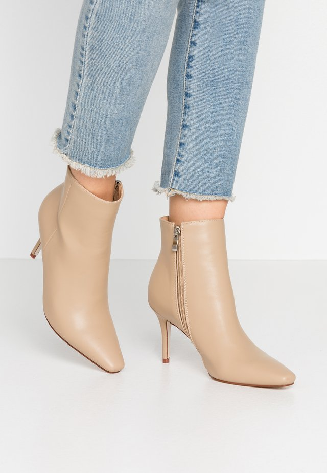 WIDE FIT PRALINE - Ankle boots - nude