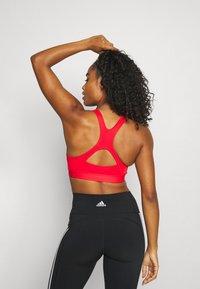 adidas Performance - BRA - Sport-bh met medium support - vivid red/team real magenta - 2