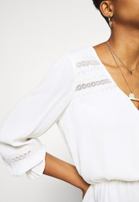 Forever New - RAINA 3/4 SLEEVE TIE FRONT BLOUSE - Blouse - cream - 4