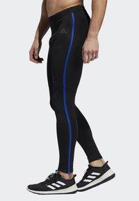 adidas Performance - OWN THE RUN LONG TIGHTS - Caleçon long - black/blue - 2