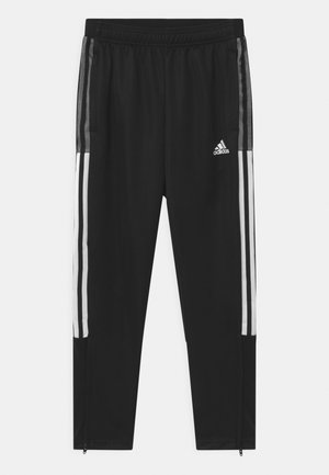 TIRO UNISEX - Tracksuit bottoms - black