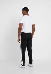 Polo Ralph Lauren - Träningsbyxor - polo black - 2