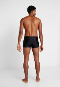 adidas Performance - FIT - Swimming trunks - black/white - 2