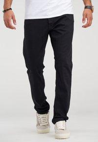 Jack & Jones - CLARK JJARIS  - Straight leg jeans - black denim - 0