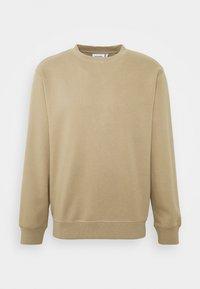 STANDARD - Sweatshirt - beige