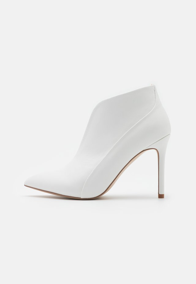 PATCH - High heeled ankle boots - white