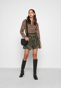 Scotch & Soda - SLIM FIT  - Button-down blouse - black/orange/lilac - 1