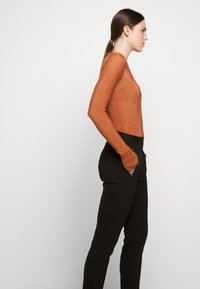 HUGO - HALELI - Leggings - Trousers - black - 3