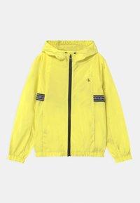 Calvin Klein Jeans - LOGO TAPE UNISEX - Light jacket - yellow - 0