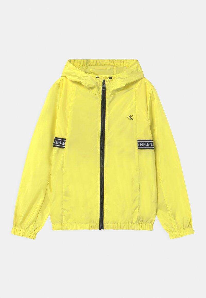 Calvin Klein Jeans - LOGO TAPE UNISEX - Light jacket - yellow